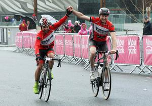 Hand and hand in the rain across the line at the Gran Fondo. Pic: Freddie Parkinson/Press Eye.