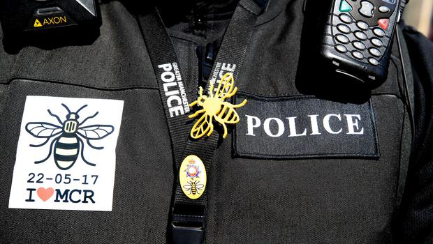 A police officer wears stickers and a bee badge (Peter Byrne/PA)