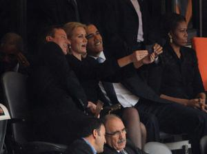 Say cheese: David Cameron and Barack Obama lean in for the now infamous selfie with Danish leader, Helle Thorning-Schmidt at Nelson Mandela's memorial