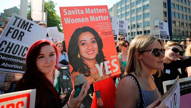 People attend a People Before Profit protest calling of for provision of Abortion in Northern Ireland, at Belfast City Hall. PRESS ASSOCIATION Photo. Picture date: Monday May 28, 2018. See PA story IRISH Abortion. Photo credit should read: Niall Carson/PA Wire