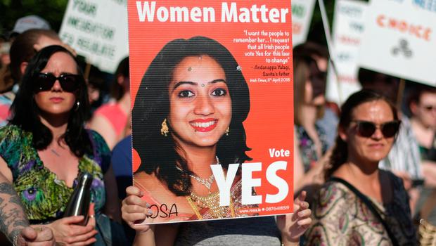 A woman holds a poster of Savita Halappanava at Belfast City Hall, during a People Before Profit protest calling of for provision of Abortion in Northern Ireland.  PRESS ASSOCIATION Photo. Picture date: Monday May 28, 2018. See PA story IRISH Abortion. Photo credit should read: Niall Carson/PA Wire