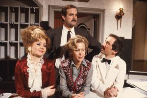 An episode of classic sitcom Fawlty Towers has been removed from a streaming service because it contains 'racial slurs' (BBC/PA)