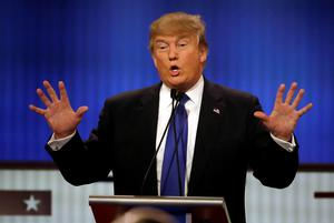 Republican presidential candidate, businessman Donald Trump assures America he has no size issues during Republican presidential primary debate at Fox Theatre, Thursday, March 3, 2016, in Detroit. (AP Photo/Carlos Osorio)