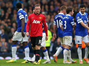LIVERPOOL, ENGLAND - APRIL 20:  Wayne Rooney of Manchester United walks off the pitch after the Barclays Premier League match between Everton and Manchester United at Goodison Park on April 20, 2014 in Liverpool, England.  (Photo by Alex Livesey/Getty Images)