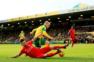 NORWICH, ENGLAND - JANUARY 23:  Steven Naismith of Norwich City is fouled by Alberto Moreno of Liverpool resulting in the penalty kick during the Barclays Premier League match between Norwich City and Liverpool at Carrow Road on January 23, 2016 in Norwich, England.  (Photo by Stephen Pond/Getty Images)