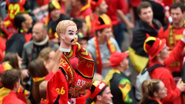 A photo taken on July 1, 2016 shows a doll head painted with Belgium's colors as Belgium's supporters wcheer their team at the main square, La Grand Place, in Lille ahead of the Euro 2016 football tournament quarter final match between Belgium and Wales. / AFP PHOTO / PHILIPPE HUGUENPHILIPPE HUGUEN/AFP/Getty Images