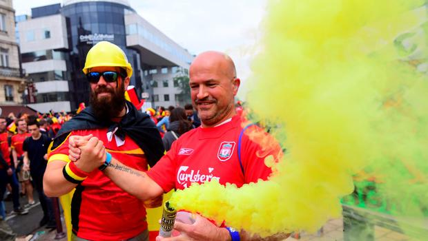 Belgium supporters hold a smoke bomb in a street of Lille on July 1, 2016 before the Euro 2016 quarter-final football match between Wales and Belgium. / AFP PHOTO / EMMANUEL DUNANDEMMANUEL DUNAND/AFP/Getty Images