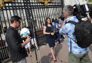 A media crew film outside Buckingham Palace in central London, as the Duchess of Cambridge was admitted to hospital in the early stages of labour this morning, Kensington Palace has said. Kate and husband William arrived at the private Lindo Wing of St Mary's Hospital in London by car without a police escort just before 6am. Anthony Devlin/PA Wire
