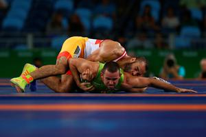 RIO DE JANEIRO, BRAZIL - AUGUST 15:  Nikolaev Bayryakov of Bulgaria and Ahmed Mohamed Ibrahim Saad of Egypt compete during the Men's Greco-Roman 85 kg Repechage on Day 10 of the Rio 2016 Olympic Games at Carioca Arena 2 on August 15, 2016 in Rio de Janeiro, Brazil.  (Photo by Ryan Pierse/Getty Images)