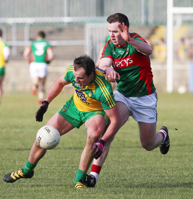 Up close: Donegal's Michael Murphy holds off Shane Nally