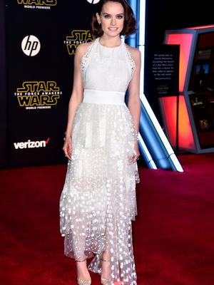 """Daisy Ridley arrives at the world premiere of """"Star Wars: The Force Awakens"""" at the TCL Chinese Theatre on Monday, Dec. 14, 2015, in Los Angeles. Ridley plays the role of Rey in the film. (Photo by Jordan Strauss/Invision/AP)"""