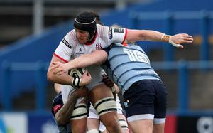 Ulster's Kieran Treadwell is tackled by Kristian Dacey of Cardiff. Pic ©INPHO/Billy Stickland