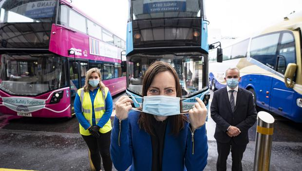 Face coverings compulsory on NI Public Transport from July 10  Infrastructure Minister Nichola Mallon, Translink Group Chief Executive Chris Conway  and  Translink's Nicole Green (left) remind everyone that face coverings will be compulsory when travelling on public transport from Friday 10th July 2020.