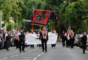 Orange Order members march on Woodvale Road in Belfast as part of the annual Twelfth of July parades across Northern Ireland. PA