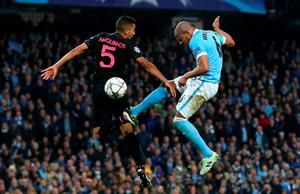 MANCHESTER, UNITED KINGDOM - APRIL 12:  Fernando of Manchester City jumps with Marquinhos of Paris Saint-Germain during the UEFA Champions League quarter final second leg match between Manchester City FC and Paris Saint-Germain at the Etihad Stadium on April 12, 2016 in Manchester, United Kingdom.  (Photo by Alex Livesey/Getty Images)