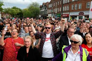 WATFORD, UNITED KINGDOM - JUNE 07:  Labour supporters cheer as Jeremy Corbyn, Leader of the Labour Party speaks during a campaign rally at the Parade on June 7, 2017 in Watford, United Kingdom. The Labour leader is holding six rallies across Scotland, England and Wales today on the final day before polling day in the General Election.  (Photo by Matt Cardy/Getty Images)