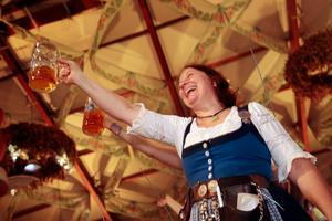 MUNICH, GERMANY - OCTOBER 05:  Waitresses and revellers celebrate the last minutes of the 2014 Oktoberfest on October 5, 2014 in Munich, Germany. The 181st Oktoberfest ends today, having drawn visitors from around the globe in the world's largest beer fest.  (Photo by Johannes Simon/Getty Images)