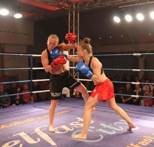 Tough night: Cathy McAleer soaks up a right hand from Martyna Ciaskowska on her way to victory