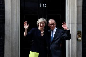 LONDON, ENGLAND - JULY 13:  British Prime Minister Theresa May and husband Philip May wave outside 10 Downing Street on July 13, 2016 in London, England. Former Home Secretary Theresa May becomes the UK's second female Prime Minister after she was selected unopposed by Conservative MPs to be their new party leader. She is currently MP for Maidenhead.  (Photo by Carl Court/Getty Images) *** BESTPIX ***