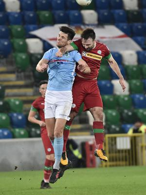 PACEMAKER BELFAST 21/01/2020 Cliftonville v Ballymena County Antrim Shield Final Cliftonville's Jamie Harney   and Ballymena's  Adam Lecky during this evening's game at Windsor Park in Belfast. Photo Colm Lenaghan/Pacemaker Press