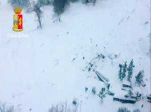 This image grab made from a video handout released by the Polizia di Stato on January 19, 2017 shows an aerial view of the Hotel Rigopiano, near the village of Farinfola, on the eastern lower slopes of the Gran Sasso mountain, engulfed by a powerful avalanche.  / AFP PHOTO / Polizia di Stato / Handout / Getty Images