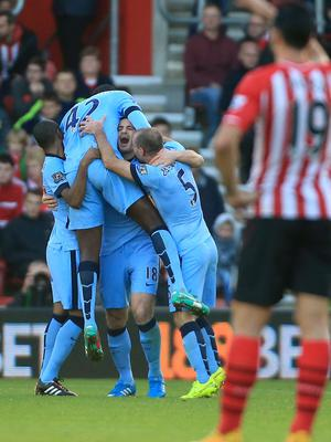 Manchester City's Frank Lampard celebrates scoring his sides second goal of the game with team-mates during the Barclays Premier League match at St Mary's Stadium, Southampton. Nick Potts/PA Wire.