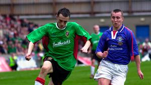 Glentoran's Michael Halliday outpaces Linfield defender John Easton during the 2001 Irish Cup final.