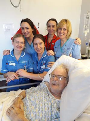 From left, Staff Nurses Sophie Andrews, Lorna Brownlee, Orla Carr, Sister Louise Brown and Staff Nurse Rosemary Ogle with Colin McAlpin