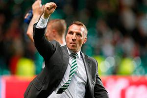 Celtic manager Brendan Rodgers acknowledges the fans after the UEFA Champions League Play-Off