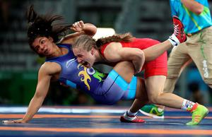 RIO DE JANEIRO, BRAZIL - AUGUST 17:  Orkhon Purevdorj (L) of Mongolia competes against Valeriia Koblova Zholobova of Russia during a Women's Freestyle 58kg 1/8 Final bout on Day 12 of the Rio 2016 Olympic Games at Caioca Arena 2 on August 17, 2016 in Rio de Janeiro, Brazil.  (Photo by Lars Baron/Getty Images)