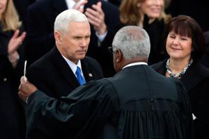 WASHINGTON, DC - JANUARY 20:  Supreme Court Justice Clarence Thomas (C) congratulates U.S. Vice President Mike Pence (L) after he took the oath of office as his wife Karen Pence looks on, on the West Front of the U.S. Capitol on January 20, 2017 in Washington, DC. In today's inauguration ceremony Donald J. Trump becomes the 45th president of the United States.  (Photo by Chip Somodevilla/Getty Images)