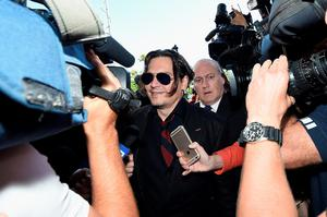 GOLD COAST, AUSTRALIA - APRIL 18:  Johnny Depp arrives at Southport Magistrates Court on April 18, 2016 in Gold Coast, Australia. Heard is facing two counts of breaching Australia's quarantine laws by allegedly bringing in her pet dogs Pistol and Boo on a private jet in May 2015.  (Photo by Matt Roberts/Getty Images)