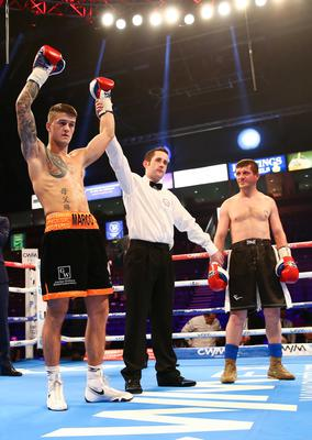 28th February 2015   ?William Cherry/Presseye  Marc McCullough with Malkhaz Tatrishvali during Saturdays Featherweight contest at the Odyssey Arena, Belfast