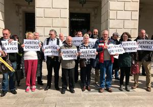 Victims of institutional child abuse protest at Stormont Castle, after warring politicians failed to deliver a promised apology and financial redress. PA