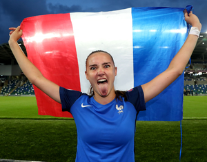 Joy: France's Helene Fercocq savours the moment after her side's semi-final win.