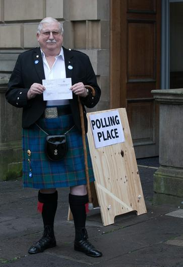 EDINBURGH, SCOTLAND - SEPTEMBER 18:  James Fraser holds up his voting card having just voted at Lothian Chambers polling station in central Edinburgh on September 18, 2014 in Edinburgh, Scotland. After many months of campaigning the people of Scotland today head to the polls to decide the fate of their country. The referendum is too close to call but a Yes vote would see the break-up of the United Kingdom and Scotland would stand as an independent country for the first time since the formation of the Union.  (Photo by Matt Cardy/Getty Images)