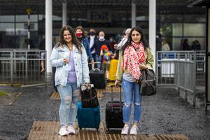 Aleksanda Sabalina (left) and Edith Mikutenaite who live in Newtownabbey pictured leaving Belfast International Airport after arriving on Easyjet's 10am EJU6672 flight from Barcelona, Spain. PA Photo. Picture date: Monday July 27, 2020. See PA story ULSTER Coronavirus. Photo credit should read: Liam McBurney/PA Wire