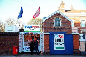 LIVERPOOL, ENGLAND - APRIL 20:  Fand grab a bite to eat prior to the Barclays Premier League match between Liverpool and Everton at Anfield, April 20, 2016, Liverpool, England  (Photo by Clive Brunskill/Getty Images)