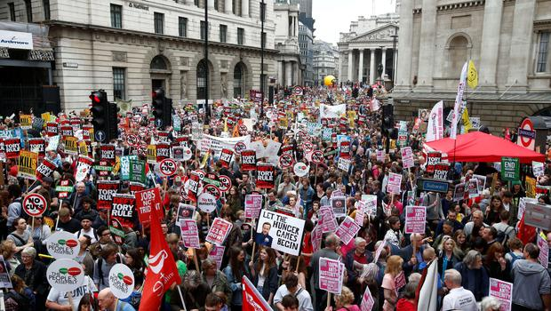 Demonstrators crowd the area around the Bank of England as they gather for the start of a protest against the British government's spending cuts and austerity measures in London on June 20, 2015. The national demonstration against austerity was organised by People's Assembly against government spending cuts.  AFP PHOTO / JUSTIN TALLISJUSTIN TALLIS/AFP/Getty Images