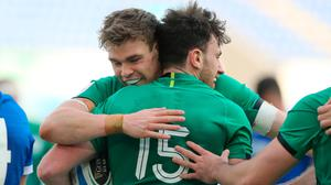 Hugo Keenan celebrates with Garry Ringrose after scoring Ireland's third try in Rome.