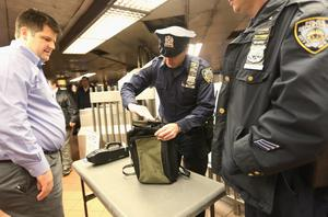 NEW YORK, NY - APRIL 15:  A New York Police Department officer inspects a man's bag in Grand Central Terminal in Manhattan on April 15, 2013 in New York City. The city has announced it will implement heightened security measures in response to today's bombings at the Boston Marathon.  (Photo by Mario Tama/Getty Images)