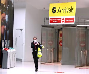 A staff member in Arrivals at Belfast City airport in Northern Ireland (Brian Lawless/PA)