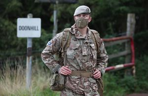 A soldier from the Royal Scots Dragoon Guards wears a face mask during the Solway Eagle exercise at the Kirkcudbright training area (Andrew Milligan/PA)