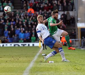 Northern Ireland's Stuart Dallas and Finland's Paulus Arajuuri during today's game at Windsor Park in Belfast. David Maginnis/Pacemaker Press.