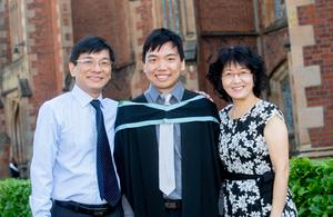 International student Daniel Hsu Wen graduated today with a Bachelor of Biomedical Science from the School of Medicine, Dentistry and Biomedical Sciences at Queen's University. He is pictured with his mother and father who travelled from Malaysia to celebrate.