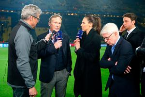 DORTMUND, GERMANY - APRIL 11: (L-R) Stadium speaker Norbert Dickel of Dortmund, Hans Joachim Watzke, chairman of the board, sky fiel reporter Esther Sedlacezk and Reinhard Rauball of Dortmund look concerned about the bomb attack to the bus of Dortmund during the UEFA Champions League Quarter Final first leg match between Borussia Dortmund and AS Monaco at Signal Iduna Park on April 11, 2017 in Dortmund, Germany.  (Photo by Christof Koepsel/Bongarts/Getty Images)