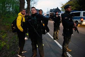 Police escort Dortmund's players after the team bus of Borussia Dortmund had some windows broken by an explosion some 10km away from the stadium prior to the UEFA Champions League 1st leg quarter-final football match BVB Borussia Dortmund v Monaco in Dortmund, western Germany on April 11, 2017.  / AFP PHOTO / Odd ANDERSENODD ANDERSEN/AFP/Getty Images