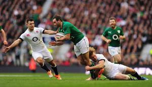 LONDON, ENGLAND - FEBRUARY 22:  Ireland wing Dave Kearney is tackled by Billy Twelvetrees as Danny Care (l) looks on during the RBS Six Nations match between England and Ireland at Twickenham Stadium on February 22, 2014 in London, England.  (Photo by Stu Forster/Getty Images)