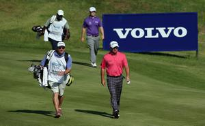 KAVARNA, BULGARIA - MAY 19:  Graeme McDowell of Northern Ireland and Branden Grace of South Africa and their caddies approach the second green during the semi-final of the Volvo World Match Play Championship at Thracian Cliffs Golf & Beach Resort on May 19, 2013 in Kavarna, Bulgaria.  (Photo by Andrew Redington/Getty Images)