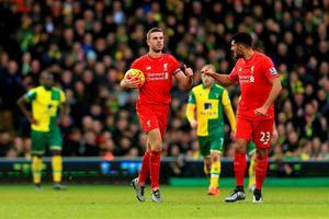 NORWICH, ENGLAND - JANUARY 23:  Jordan Henderson (L) of Liverpool celebrate with Emre Can (R) after scoring his team's second goal during the Barclays Premier League match between Norwich City and Liverpool at Carrow Road on January 23, 2016 in Norwich, England.  (Photo by Stephen Pond/Getty Images)